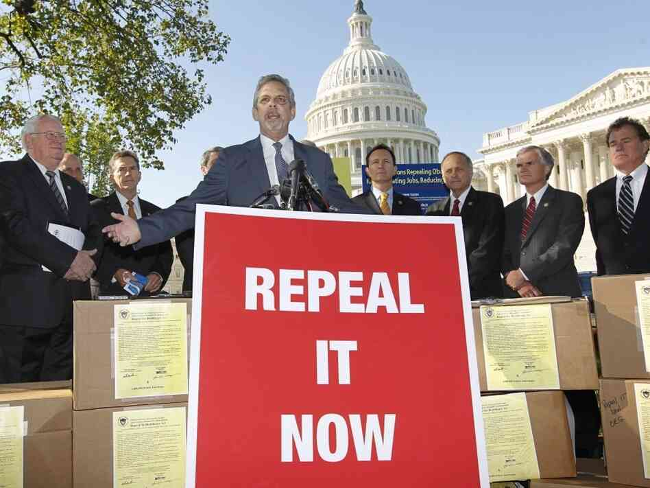 "Flanked by conservative lawmakers, Ken Hoagland, chairman of the Repeal It Now.org campaign, center, criticizes President Obama's national heath care plan, often called ""Obamacare,"" on Oct. 5, 2011, during a news conference in Washington."