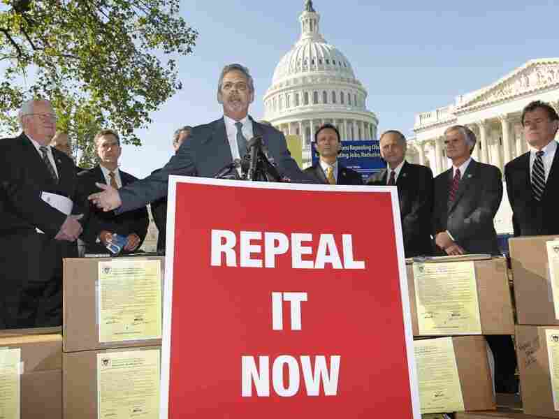 """Flanked by conservative lawmakers, Ken Hoagland, chairman of the Repeal It Now.org campaign, center, criticizes President Obama's national heath care plan, often called """"Obamacare,"""" on Oct. 5, 2011, during a news conference in Washington."""