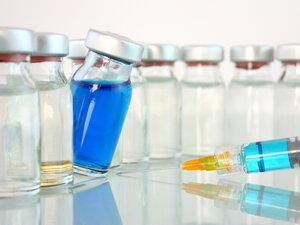 A bottle of blue medicine teeters.