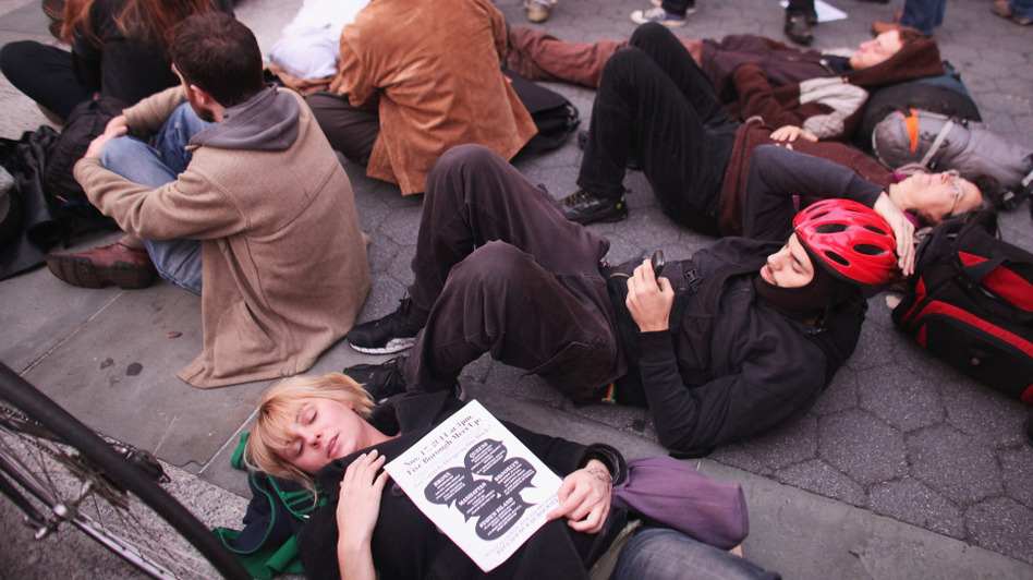 Occupy Wall Street protesters regroup in Foley Square after New York City police in riot gear removed the protesters from Zuccotti Park early Tuesday. The evacuation followed similar moves in Oakland, Calif., and Portland, Ore.  (Getty Images)