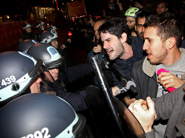 Occupy Wall Street protesters clash with police at Manhattan's Zuccotti Park after New York police officers ordered them to leave their longtime encampment.