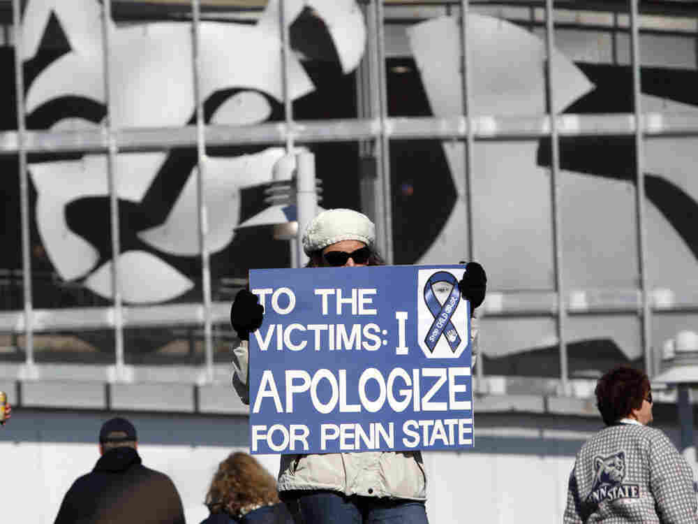 A Penn State alum holds a sign at this past Saturday's NCAA college football game in State College, Pa.  In our first hour, we will talk about the victims of childhood sexual abuse, and the options that are available to help them.