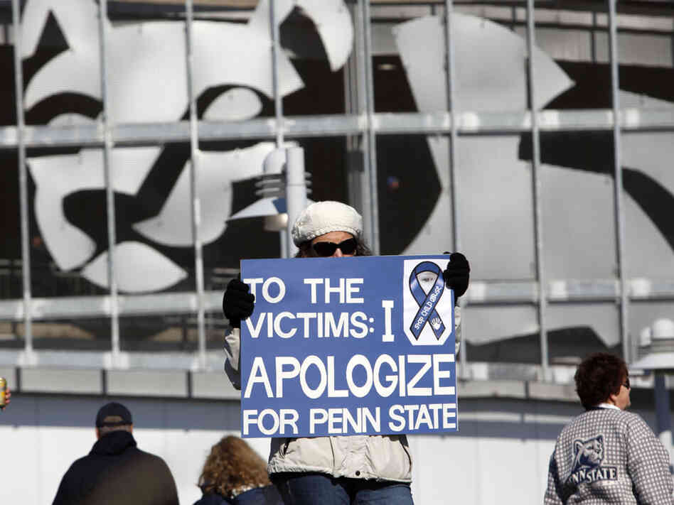 A Penn State alum holds a sign at this past Saturday's NCAA college football game in State College, Pa.  In our first hour, we will talk about the victims of