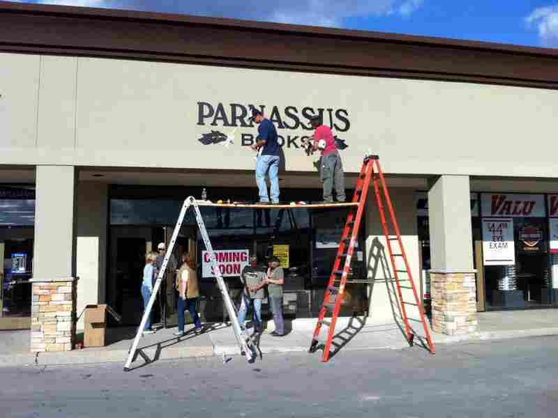 Parnassus in progress: Workers put some final touches on the front of the bookstore. The store is named after Mount Parnassus, home of literature and learning in Greek mythology.