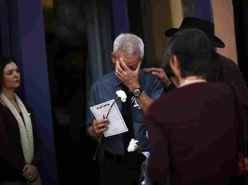 Ross Zimmerman, father of Gabe Zimmerman, mourns at his son's memorial service in Tucson, Arizona Jan. 17.