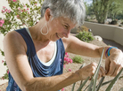 Suzi Hileman inspects an aloe on her front porch on Wednesday, Aug. 24.