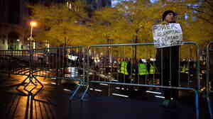 A solitary Occupy Wall Street protester held a sign outside a nearly empty Zuccotti Park in Manhattan earlier today (Nov. 16, 2011).