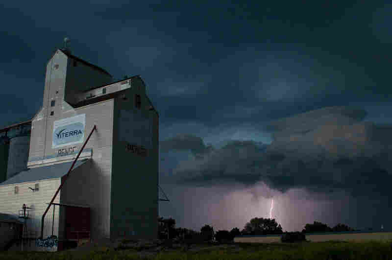 A sky full of light, texture and a beautiful lightning show by a grain elevator in Pense, Saskatchewan