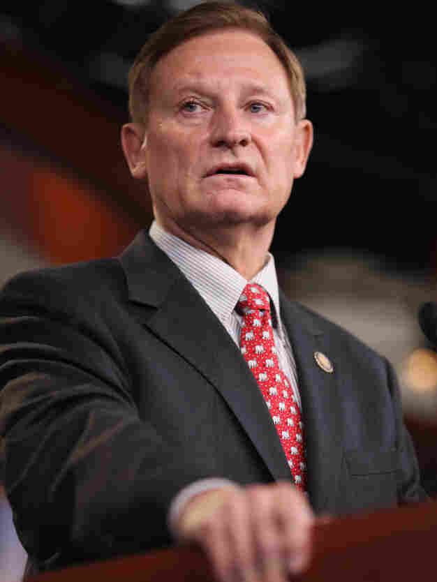 House Financial Services Committee Chairman Spencer Bachus faces questions about his stock purchases.