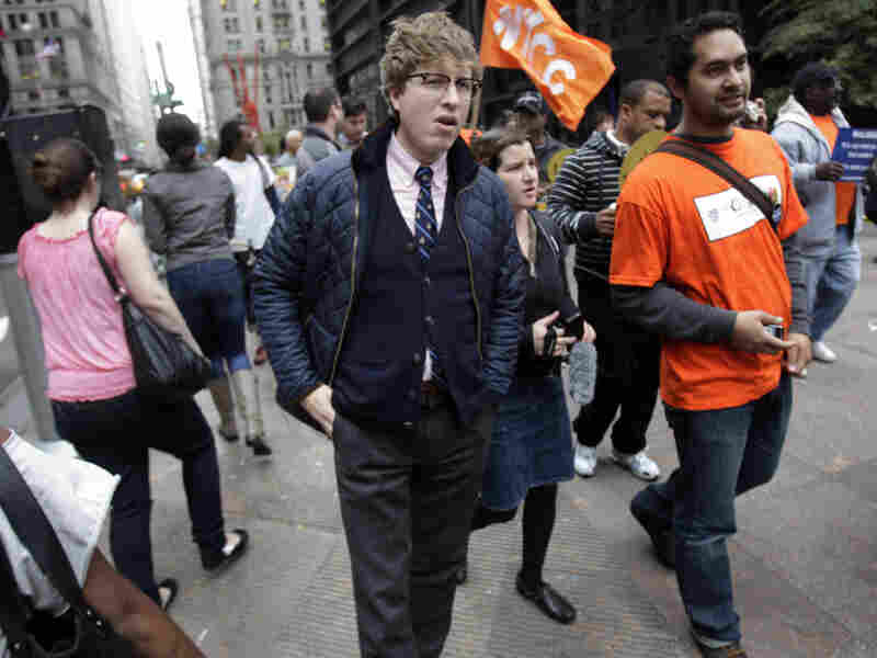 "Known online as the ""Hipster Cop,"" Detective Rick Lee (center) walks with protesters in New York in October. The plainclothes officer has been doing community affairs work at the Occupy Wall Street protest."