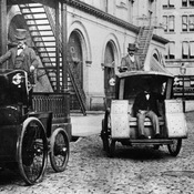 Morris and Salom Electrobats are seen in front of the Old Metropolitan Opera House on 39th Street in the Manhattan borough of New York, 1898.