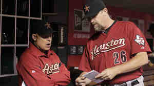 Where are we going, skip? Houston Astros manager Brad Mills, left, and pitching coach Doug Brocail.