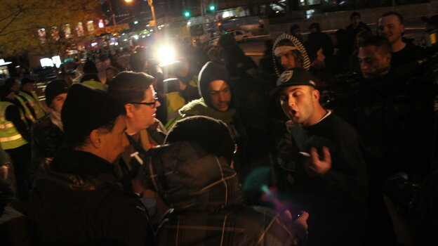 Occupy protesters argue with a passerby.