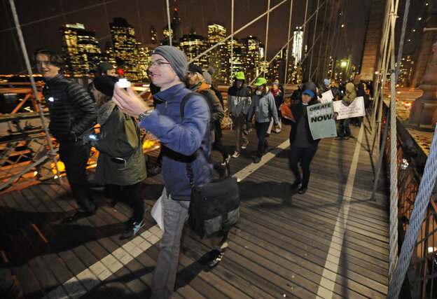 Occupy Wall Street protesters walk across the Brooklyn Bridge. Progressive groups staged similar bridge marches in several cities in an event that was planned weeks ago, but happened to coincide with rallies marking two months since the start of the Occupy movement.