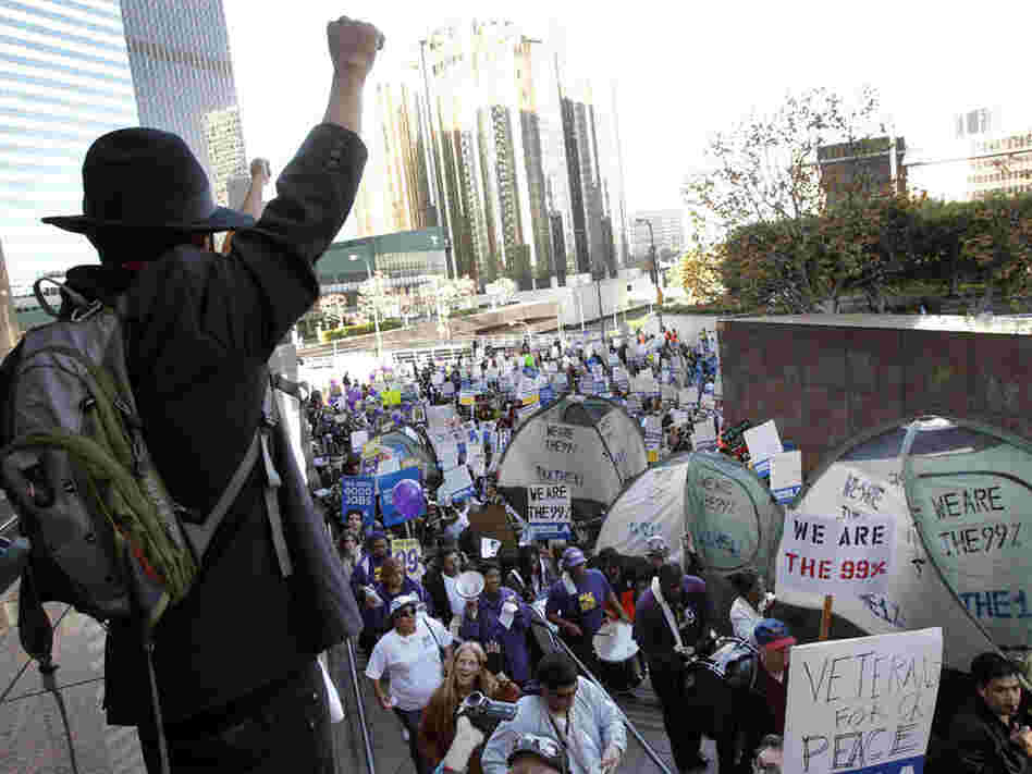 Occupy protesters march through buildings during a rally in Los Angeles, one of several nationwide on Thursday.