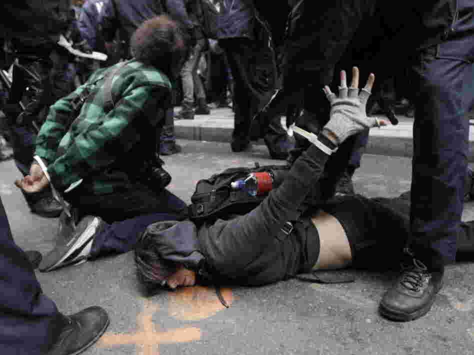 Police officers arrest demonstrators affiliated with the Occupy Wall Street movement in New York on Thursday.
