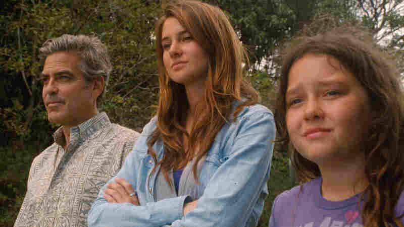 Island Son: George Clooney (left, with Shailene Woodley and Amara Miller) navigates tricky territory as a Hawaii man whose wife is on life support.