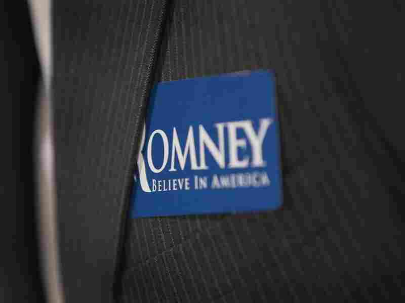 A supporter of Republican presidential candidate former Massachusetts Governor Mitt Romney wears a campaign sticker on his suit jacket during a campaign rally at the American Polish Cultural Center on Nov. 10, 2011 in Troy, Michigan.