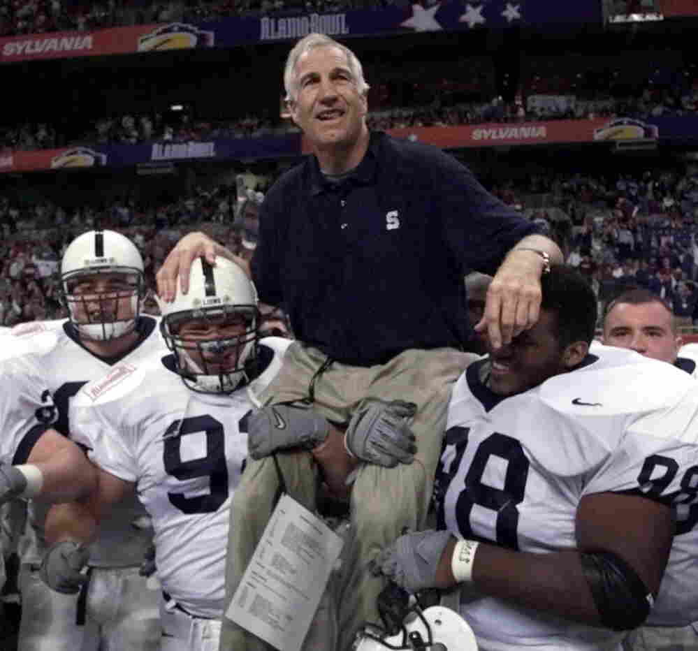 Dec. 28, 1999: Then-Penn State defensive coordinator Jerry Sandusky being carried off the field by players after the Alamo Bowl. Sandusky retired after the game.
