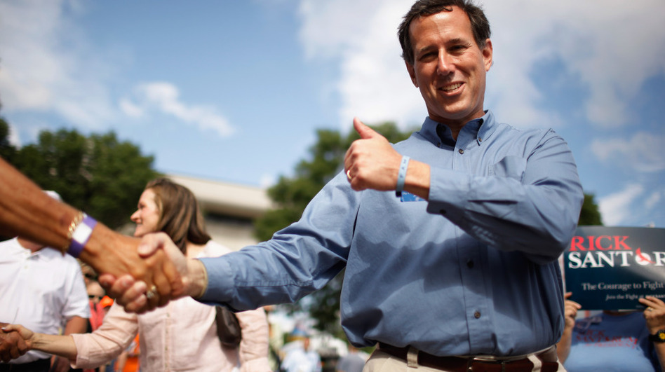 Former U.S. Sen. Rick Santorum greets voters this summer in Iowa. The Republican presidential hopeful has spent most of his professional life in politics.