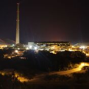 A haze can be seen at night hovering over the Asarco copper smelter, which turns copper ore into nearly pure copper bars.