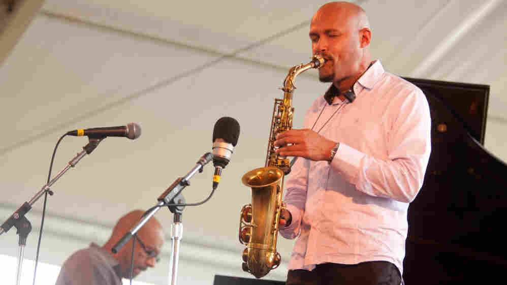 Miguel Zenón performs with his Puerto Rican Songbook group, including Luis Perdomo on piano (left), on the Quad stage during the Newport Jazz Festival.
