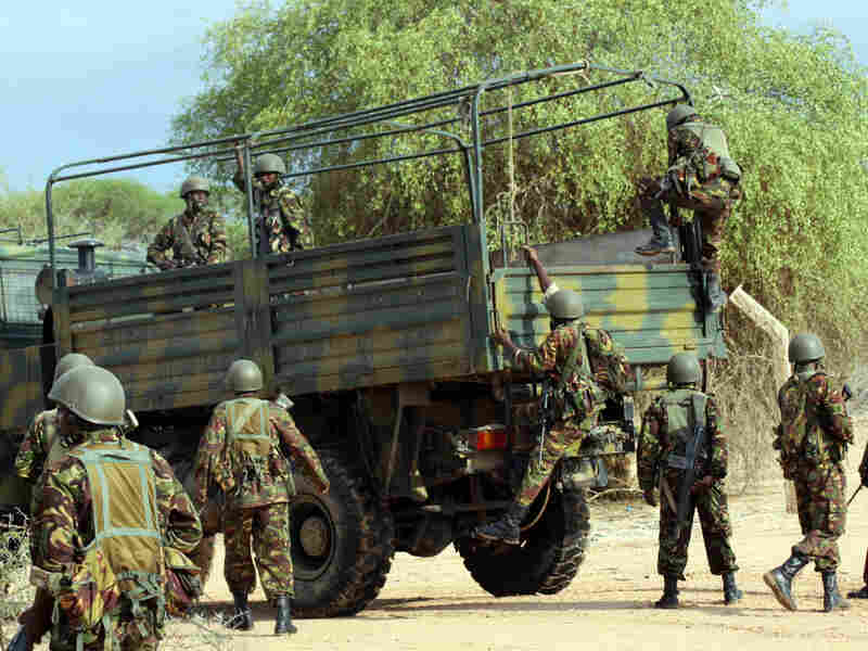 Kenyan soldiers climb into a truck as they prepare to advance near Liboi in Somalia on Oct. 18. Kenya now has a few thousand troops in the lawless country, trying to pursue a militant Islamist group called al-Shabab.