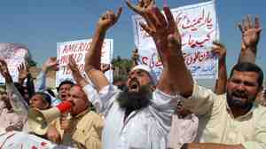 Pakistani protesters shout slogans during a protest in Multan on Oct. 14 against U.S. drone attacks in Pakistani tribal areas. Officials said U.S. drone strikes on Oct. 13 killed 10 militants, including a senior commander in the Haqqani network. Drone attacks are one way the U.S. hopes to squeeze the Haqqani militants.