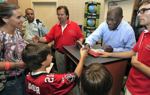 Republican presidential candidate Herman Cain shakes hands with a family during an Oct. 5 book signing in Florida.