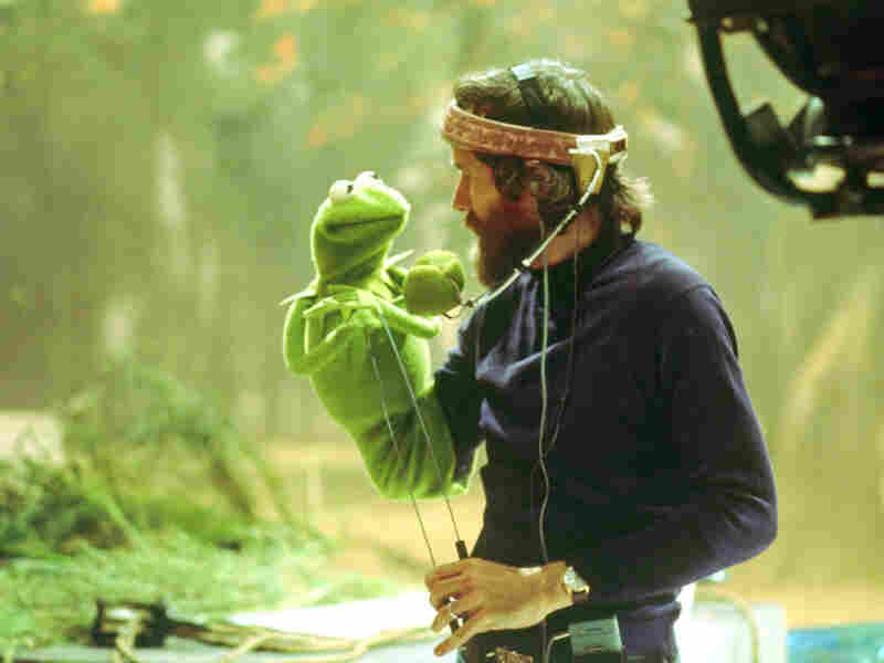 Like Muppets creator Jim Henson (with Kermit, above, in the 1970s), current Muppeteers (including Bill Barretta, below, with Pepe the Prawn) wear head-mounted microphones to capture their voice work.