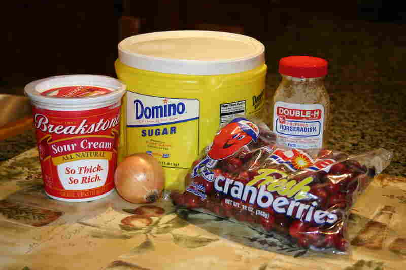 The ingredients: 2 cups whole raw cranberries; 1 small onion; 3/4 cup sour cream; 1/2 cup sugar; 2 tablespoons horseradish from a jar—white or red.