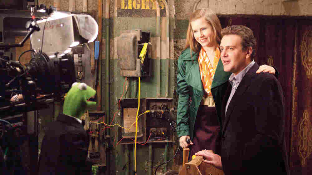 Anchorphibian: Kermit the Frog does the backstage-chat thing with Amy Adams and Jason Segel in The Muppets.