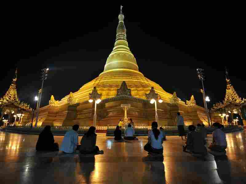 People offer prayers at the newly completed Uppatasaniti Pagoda in Naypiydaw earlier this year. It's unclear when construction on the new capital began or how much it has cost this impoverished nation where round-the-clock power is a rarity.