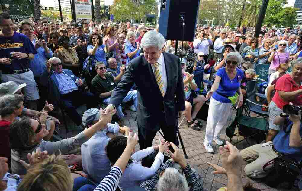 Newt Gingrich greets supporters during in Jacksonville, Fla. Thursday, Nov. 17, 2011.