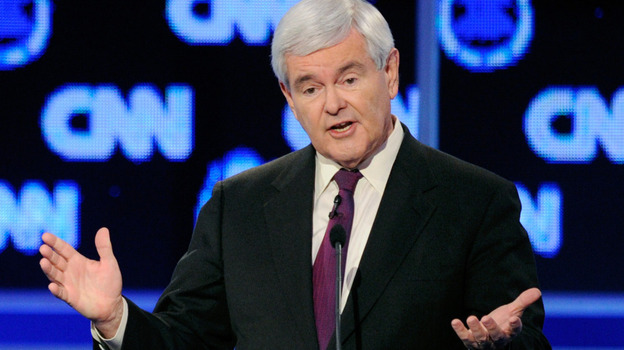 At a Republican presidential debate in Las Vegas last month, Newt Gingrich got zinged by rival Mitt Romney for coming up with idea of an individual insurance mandate. (Getty Images)