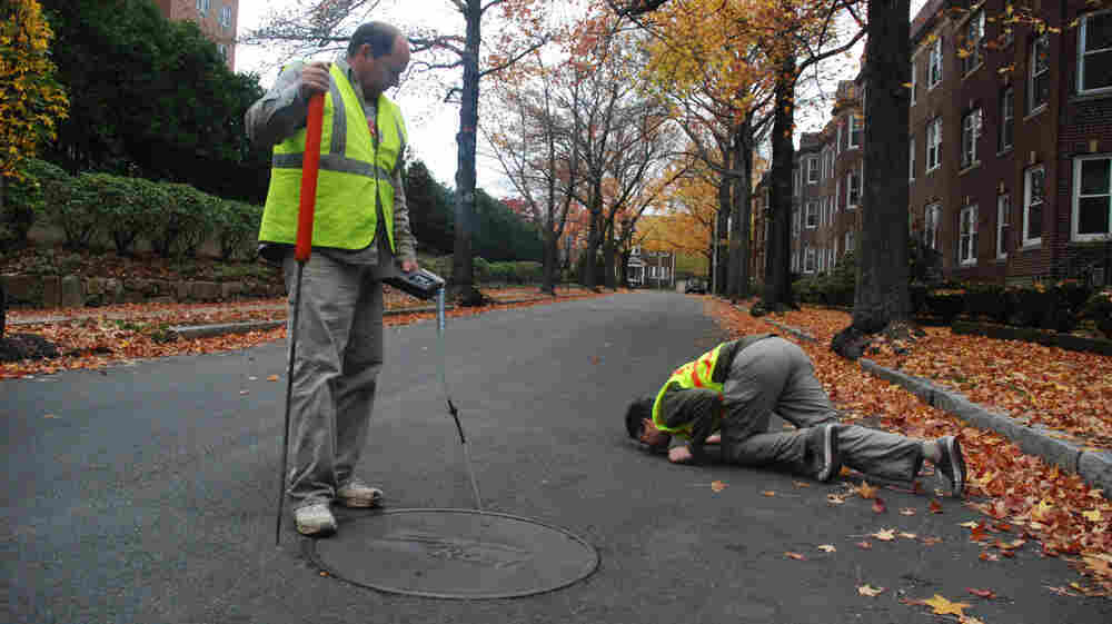 Bob Ackley, left, and Nathan Phillips measure methane levels on a Boston street. They found about 4,000 significant gas leaks after driving 785 miles of Boston and suburban roads.