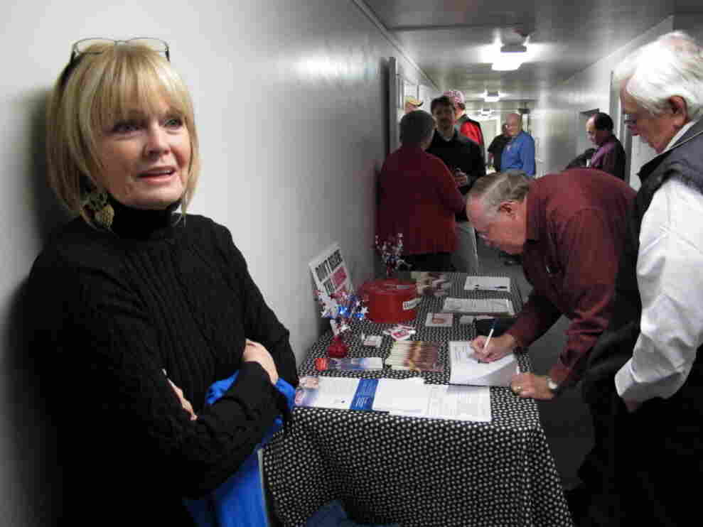 Mid-South Tea Party member Jan Allen stands by front of the sign-in desk before Thursday's meeting near Memphis.