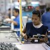 Employees of TECMA, a cross-border plant or maquiladora, work in Ciudad Juarez, Mexico. Business leaders say the quick delivery time of goods from Mexico to the U.S. can help revive manufacturing in North America.