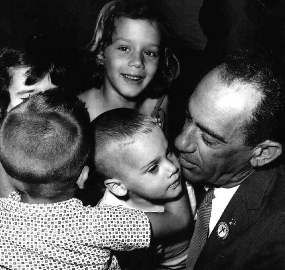 At Miami's airport, children from Cuba meet George Guarch, who worked for the Catholic Welfare Bureau in the city. Guarch took displaced children to temporary camps