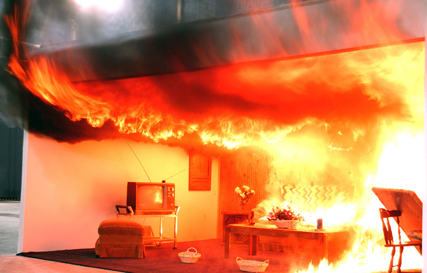A fire burns in a scale model of a living room in the ATF's Fire Research Lab in Beltsville, Maryland. Until the development of the FRL, there were no fire measurement facilities in the U.S., or anywhere, dedicated to the specific needs of the fire investigation community.