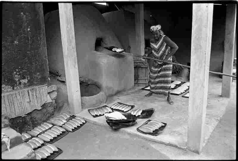 "Sokode, Togo, 1991: ""As part of a micro-finance plan, this woman received a loan to build a second oven so she could expand her bakery business."""