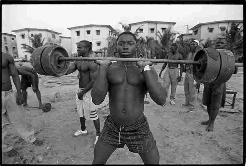 "Lagos, Nigeria, 1992: ""This man is lifting weights made from scrap metal."""