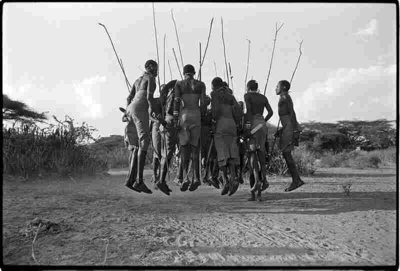 "Northern Kenya, 1990: ""Maasai men dancing a traditional warrior dance."""