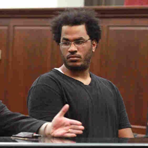 Jose Pimentel, 27, right, represented by attorney Joseph Zablocki, left, was arraigned Sunday in New York.