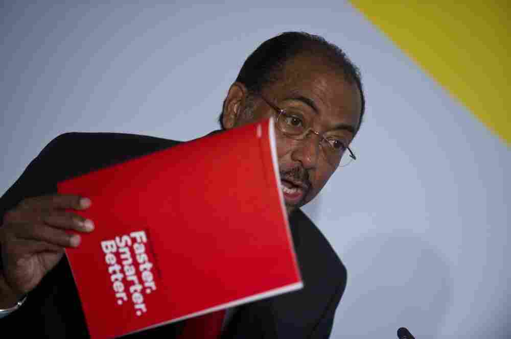 Executive Director of UNAIDS Michel Sidibé holds up a copy of the UNAIDS World AIDS Day Report 2011 as he addresses a press conference.