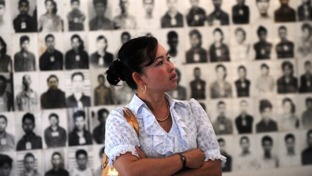 A Cambodian woman looks at portraits of Khmer Rouge victims at the Tuol Sleng genocide museum in the capital Phnom Penh on Nov. 17. Three senior Khmer Rouge leaders are on trial in what may be the last major legal case against the group's leaders. (AFP/Getty Images)