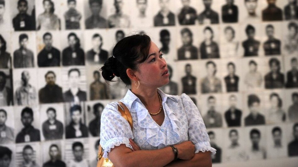 A Cambodian woman looks at portraits of Khmer Rouge victims at the Tuol Sleng genocide museum in the capital Phnom Penh on Nov. 17. Three senior Khmer Rouge leaders are on trial in what may be the last major legal case against the group's leaders.