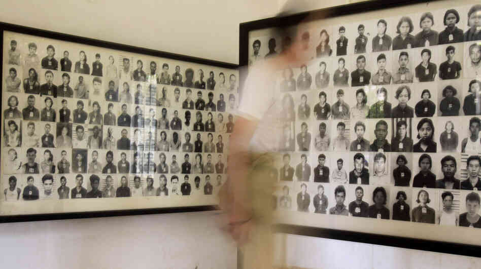 A tourist views photos of former Khmer Rouge prisoners at the Tuol Sleng genocide museum, formerly the regime's notorious S-21 prison, in Phnom Penh, Cambodia, in a photo from 2009.