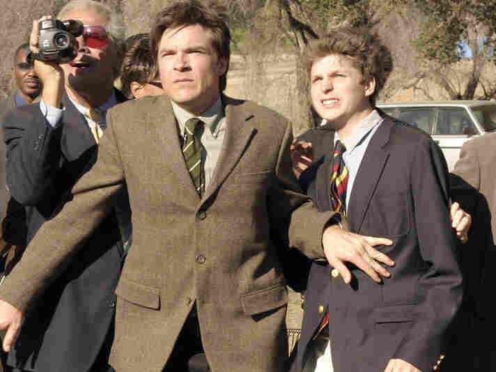 In this undated photo released by the Fox Broadcasting Company, Jason Bateman, center, and Michael Cera, right, appear in an episode of Arrested Development.