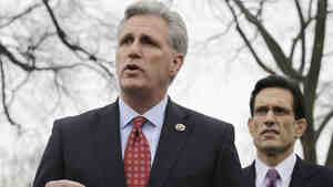 Rep. Kevin McCarthy (foreground), the No. 3 Republican in the House, speaks while Majority Leader Eric Cantor listens. McCarthy has made it clear that he wants the health overhaul law repealed. But conservative lawmakers in his hometown of Bakersfield, Calif., are accepting federal money to expand Medicaid.